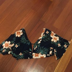 Cropped floral shirt.